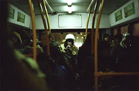 woman at the back of the bus
